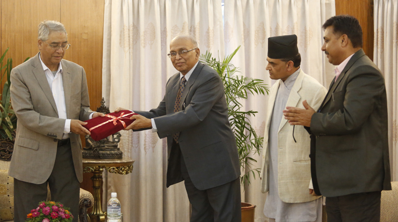 Prime Minister Sher Bahadur Deuba receives Electoral Constituency Delineation Commission's (CDC) report from Kamal Narayan Das, Chairperson on CDC during the program at PM Residence, Baluwatar in Kathmandu on Wednesday, August 30, 2017. Photo: Dipesh Shrestha/Nagarik/Republica