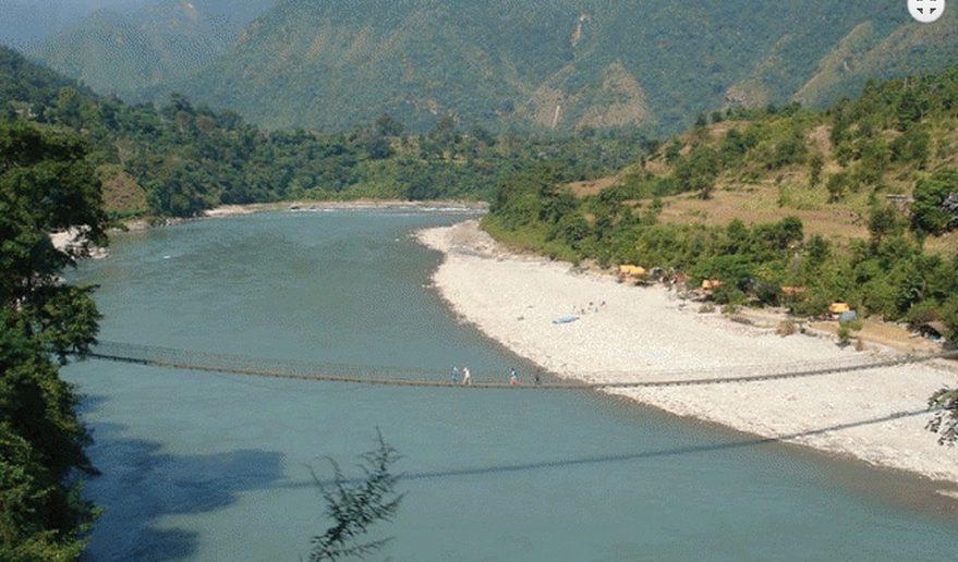This image has an empty alt attribute; its file name is Bridge-above-Trishuli-River-near-Benighat.v1-879x516.jpg